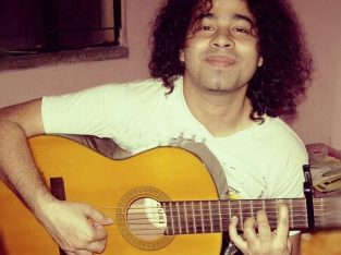 Learn to play Guitar fast with any song at home